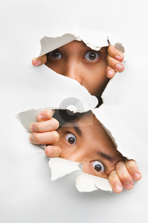 Two people peeking from hole in wall stock photo, Two people peeking from hole in wall showing their eyes only by Rudyanto Wijaya