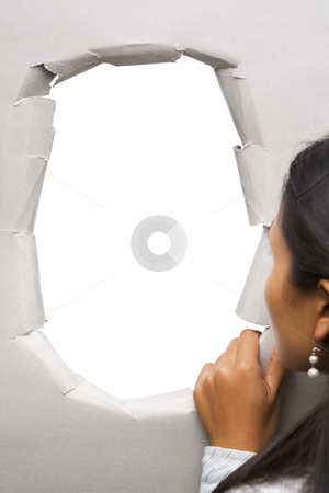 Woman peeking through hole in wall stock photo, Woman peeking through hole in wall - blank one, you can full it with image by Rudyanto Wijaya