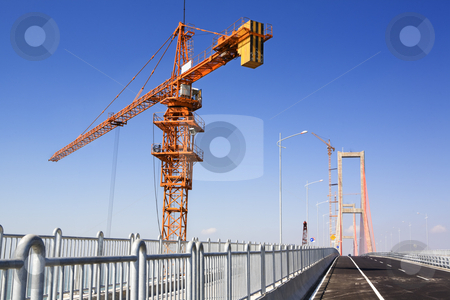 Crane in bridge area stock photo, Crane in bridge area in the morning by Rudyanto Wijaya