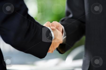 Handshake between two businessmen stock photo, Close up image of handshake between two businessmen. East Asian skin tone by Rudyanto Wijaya