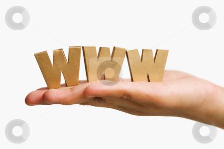 Hand holding  golden WWW stock photo, Hand holding  golden WWW alphabet blocks against white background by Rudyanto Wijaya
