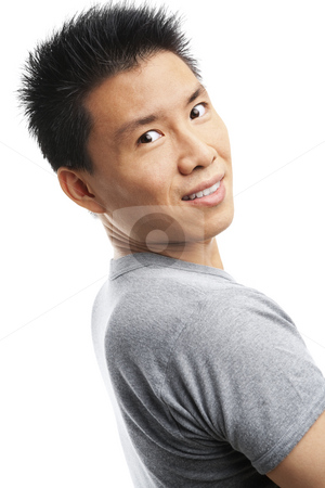 Asian young man looking at camera stock photo, Studio shot of Asian young man looking at camera by Rudyanto Wijaya