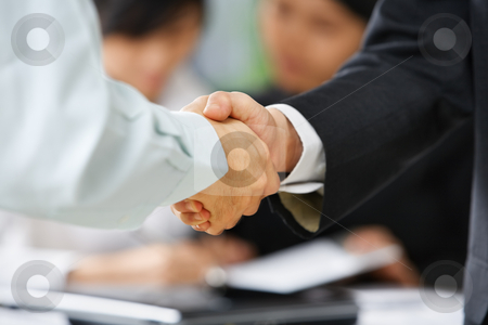 Handshake between employee and boss stock photo, Handshake between employee and boss to ilustrate he is being accepted in the team by Rudyanto Wijaya