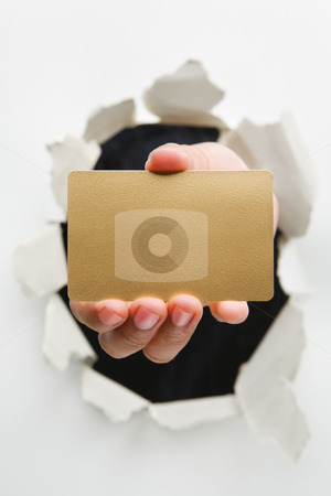 Hand breakthrough wall holding empty golden card stock photo, Hand breakthrough wall holding empty golden card - one of the breakthrough series by Rudyanto Wijaya