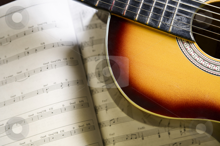 Classic guitar and music chords stock photo, Classic guitar on top of music chords by Rudyanto Wijaya