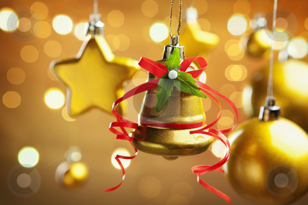 Christmas ornaments stock photo, Group of golden Christmas ornament with warm background filled with blurred light by Rudyanto Wijaya
