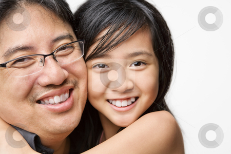 Father and daughter stock photo, Father posing with his daughter against white background by Rudyanto Wijaya