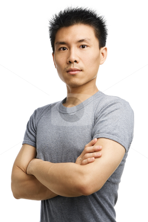 Fitness Asian young man stock photo, Studio shot of a fitness Asian young man by Rudyanto Wijaya