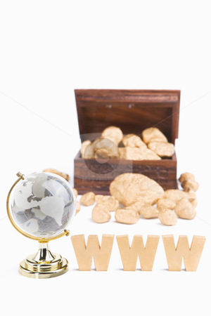 WWW bring wealth concept stock photo, WWW bring wealth concept using WWW characters block plus world globe with treasure chest and golden nuggets by Rudyanto Wijaya