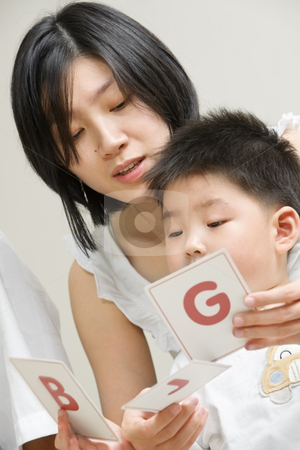 Mother tutoring her son stock photo, Asian mother tutoring her son for early education by Rudyanto Wijaya