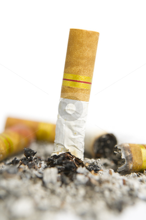 Turned off cigarette on ashtray stock photo, Turned off cigarette on white ashtray along with ashes by Rudyanto Wijaya