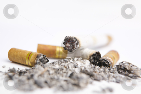 Cigarrette on ashtray stock photo, Cigarrettes on white ashtray along with ashes by Rudyanto Wijaya