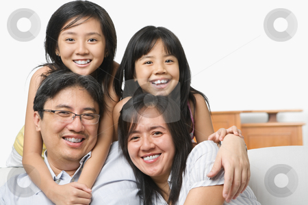 Asian family in livingroom stock photo, Asian family in posing together in livingroom by Rudyanto Wijaya