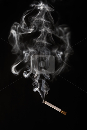 Burning cigarette falling of with smoke having abstract shape stock photo, Burning cigarette falling of with smoke having abstract shape look like a skeleton or monster by Rudyanto Wijaya