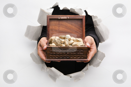 Hand breakthrough wall holding treasure chest full of golden nug stock photo, Hand breakthrough wall holding golden nuggets in treasure chest means breakthrough in finance or similar things - one of the breakthrough series by Rudyanto Wijaya