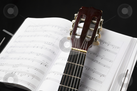 Classic guitar and music chords stock photo, Classic guitar and musical chords book in dark room by Rudyanto Wijaya