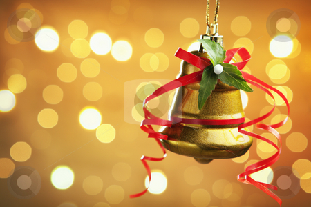 Christmas ornaments stock photo, Single Christmas bell with blurred light on warm background by Rudyanto Wijaya