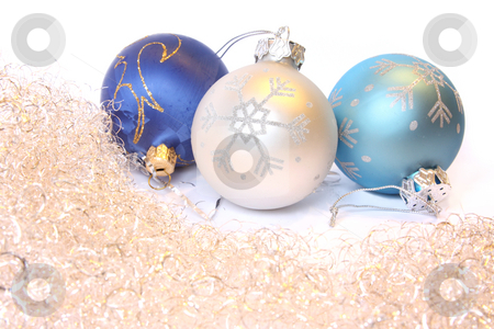 Christmas balls and a tinsel stock photo, Three Christmas balls and golden tinsel. Isolated on white by Olga Lipatova