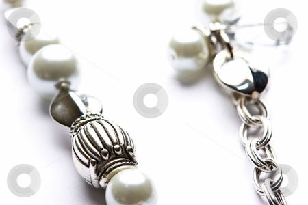 Costume Juwelery stock photo, Silver designer costume jewelery in macro on white background by Adriaan Van den Berg