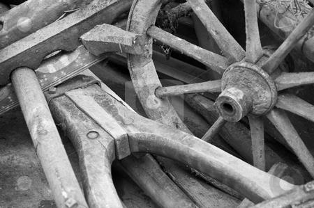 Wagon wheel and yoke stock photo, Old wooden wagon wheel and yoke in black and white by Thomas Gavagan