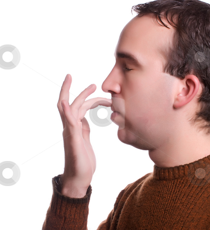 EFT stock photo, A single step in the Emotional Freedom Technique where you tap the area between your top lip and your nose to help relieve various ailments by Richard Nelson