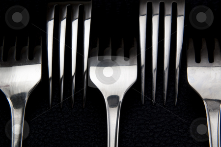 Forks stock photo, Five forks arrangement on black background. by Jeff Carson
