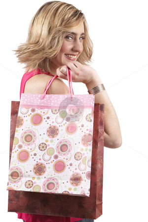 Portrait of beautiful blonde woman stock photo, Portrait of a beautiful young blonde woman wearing a pink fashionable top and holding shopping bags over her shoulder. Isolated on white background by Elena Weber (nee Talberg)