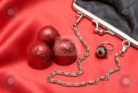 Valentines gifts with chocolates stock photo, Beautiful black purse with silver chain handles, beautiful engagement ring and chocolate truffles - perfect Valentines day gift by Elena Weber (nee Talberg)
