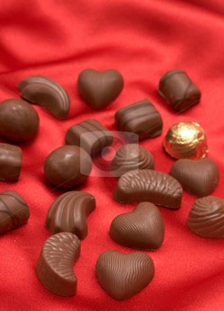 Valentines chocolates on red silk  stock photo, Assortment of Valentines chocolates on red silk background by Elena Weber (nee Talberg)