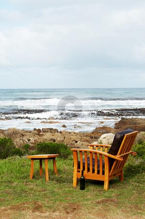 Wooden chair standing outside stock photo, Wooden chair standing outside by the ocean. Perfect leisure scene by Elena Weber (nee Talberg)