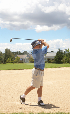 Senior golfer playing golf stock photo, Senior male golfer playing golf from the bunker on a beautiful summer day by Elena Weber (nee Talberg)