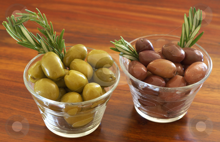 Two jars of green and black olives  stock photo, Two jars of green and black olives with stick of rosemary on wooden table background by Elena Weber (nee Talberg)