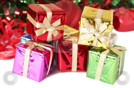 Stack of colorful Christmas gift boxes stock photo, Stack of colorful Christmas gift boxes with tinsel, balls and ribbon isolated on white background by Elena Weber (nee Talberg)
