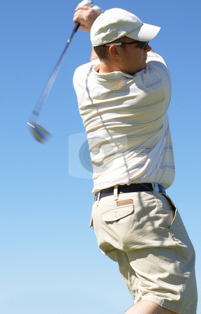 Golfer hitting the ball stock photo, Golfer hitting the ball from the tee box. Nice summer day with blue skies by Elena Weber (nee Talberg)