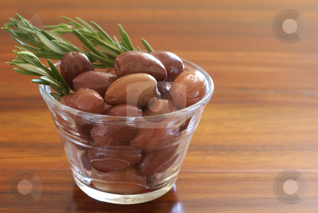 Single jar of black kalamata olives and rosemary stock photo, Single jar of black kalamata olives and rosemary on wooden table background by Elena Weber (nee Talberg)