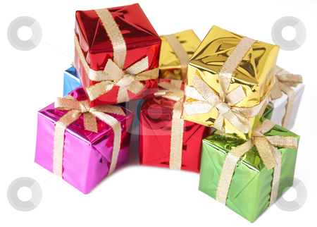 Stack of colorful gift boxes  stock photo, Stack of colorful gift boxes with golden bows isolated on white background by Elena Weber (nee Talberg)