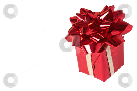 Red gift box with bow on white background stock photo, Red gift box with bow isolated on white background with copy space by Elena Weber (nee Talberg)