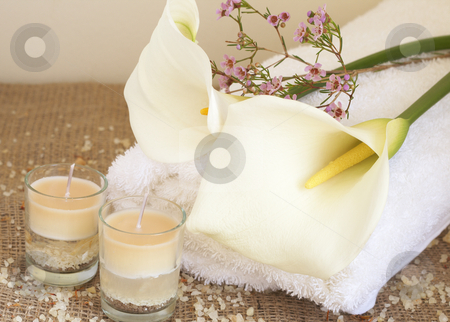 Relaxing spa scene stock photo, Relaxing spa scene with a white rolled up towel, white lillies, small pink flowers, beautiful handmade candles and bath salts by Elena Weber (nee Talberg)