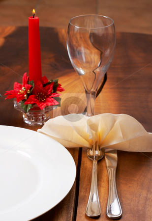 Table setting with a plate and cutlery stock photo, Table setting with a white plate, cutlery, burning candle and empty wine glass by Elena Weber (nee Talberg)