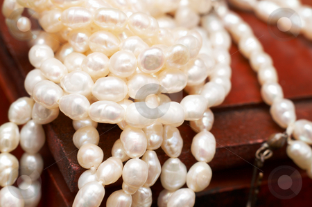 White real river pearls on wooden box stock photo, String of white real river pearls on brown wooden box - shallow depth of field by Elena Weber (nee Talberg)