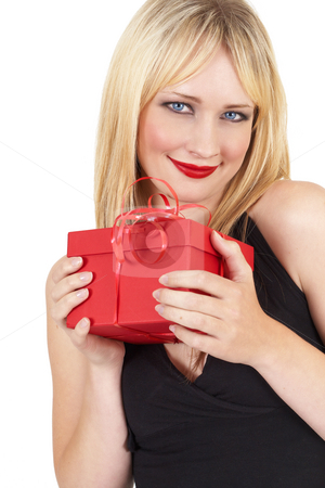 Portrait of beautiful blonde woman stock photo, Portrait of a beautiful blonde woman with light blue eyes and dramatic make-up holding a red gift box isolated on white background by Elena Weber (nee Talberg)