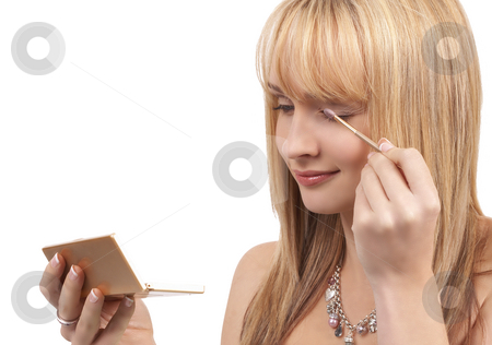 Portrait of beautiful blonde woman stock photo, Portrait of a beautiful blonde woman with light blue eyes applying natural make-up, isolated on white background by Elena Weber (nee Talberg)