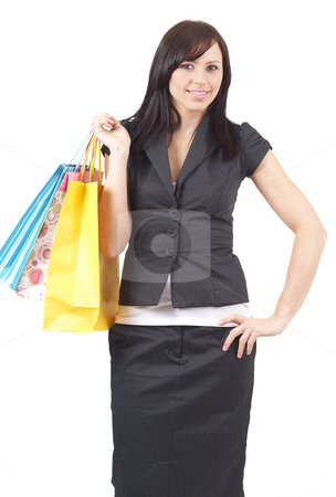 Portrait of beautiful brunette woman stock photo, Portrait of a beautiful young brunette woman holding shopping bags isolated on white background with copy space around by Elena Weber (nee Talberg)