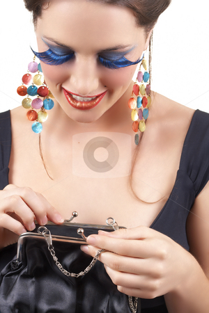 Portrait of beautiful brunette woman stock photo, Portrait of a beautiful young brunette woman with dramatic glamour make-up and fashionable earrings looking inside her purse and smiling by Elena Weber (nee Talberg)