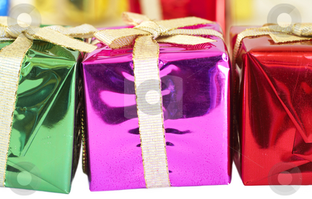 Colorful Christmas gifts stock photo, Colorful Christmas gift boxes on white background. Shallow depth of field by Elena Weber (nee Talberg)
