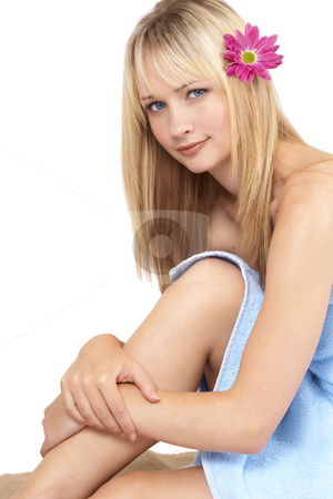 Portrait of beautiful blonde woman stock photo, Beautiful blonde woman with light blue eyes and natural make-up wrapped in towel isolated on white background by Elena Weber (nee Talberg)