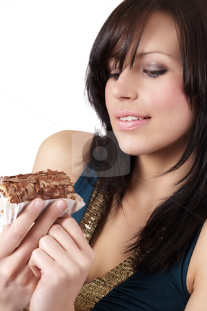 Portrait of beautiful brunette woman stock photo, Portrait of a beautiful young brunette woman tempted to eat a chocolate cake by Elena Weber (nee Talberg)