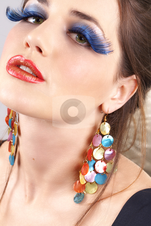 Portrait of beautiful brunette woman stock photo, Portrait of a beautiful young brunette woman with dramatic glamour make-up and fashion earrings by Elena Weber (nee Talberg)