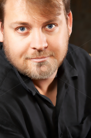 Portrait of handsome young man stock photo, Handsome young blue-eyed man relaxing at home by Elena Weber (nee Talberg)