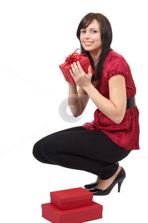 Portrait of beautiful brunette woman stock photo, Portrait of a beautiful young brunette woman opening gift boxes at a celebration by Elena Weber (nee Talberg)